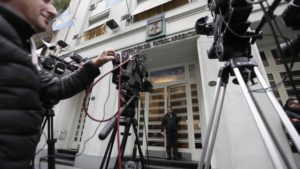 Reporters stand outside the headquarters of the Argentine Football Association (AFA) in Buenos Aires, Argentina, Tuesday, May 31, 2016. AFA's president, Luis Segura, confirmed that the Argentine soccer national team will participate in Copa America Centenario. (AP Photo/Victor R. Caivano)