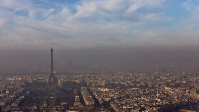 The Eiffel Tower is seen through a small-particle haze resulting in a high level air pollution index according to Airparif, the air quality monitoring agency, in Paris December 12, 2013. Airparif has noted a high level of small particle matter from combustion sources in the Ile-de-France region, including Paris, for the fourth day in a row.  REUTERS/Philippe Wojazer (FRANCE - Tags: CITYSPACE ENVIRONMENT HEALTH)